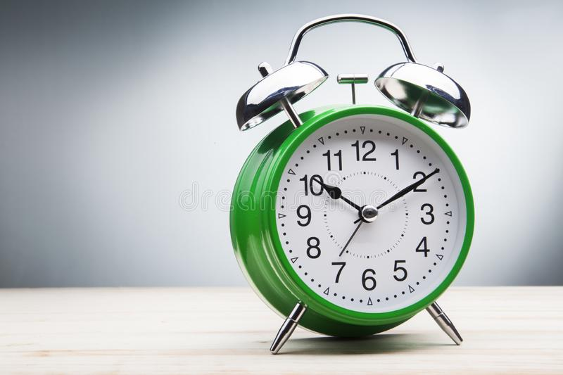 Green alarm clock morning time stock photo