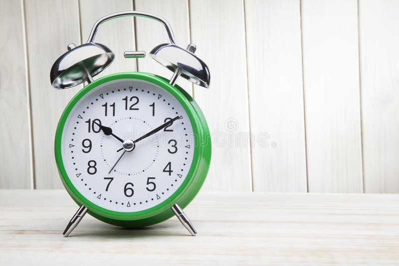 Green alarm clock morning wake-up time stock photo