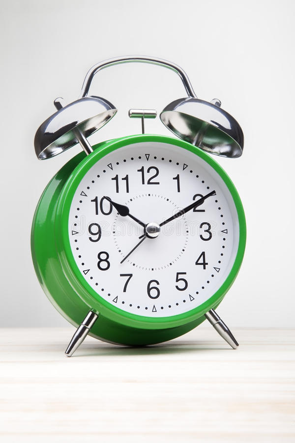 Green alarm clock morning wake-up time stock photos