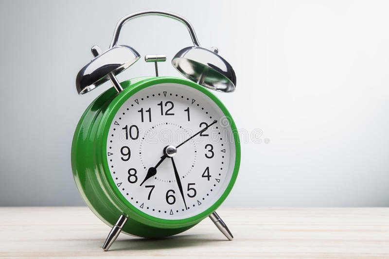 Green alarm clock morning wake-up time royalty free stock images