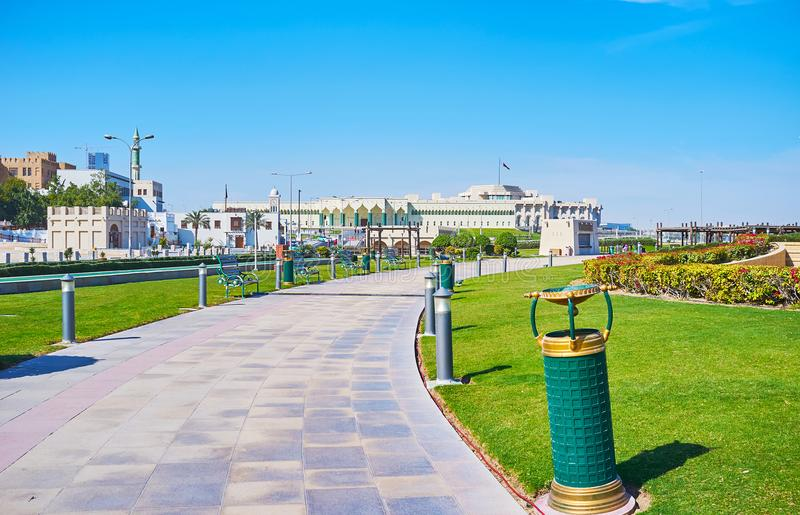 Souq Waqif Park, Doha, Qatar. The green alley of Souq Waqif Park, located next to the government quarter, the building of Amiri Diwan is seen on background, Doha stock image