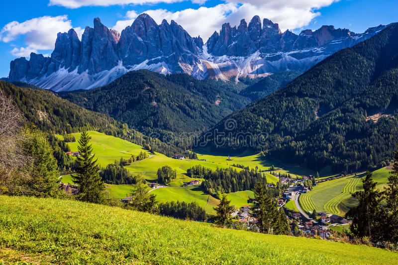 The green alpine meadows of the valley stock image
