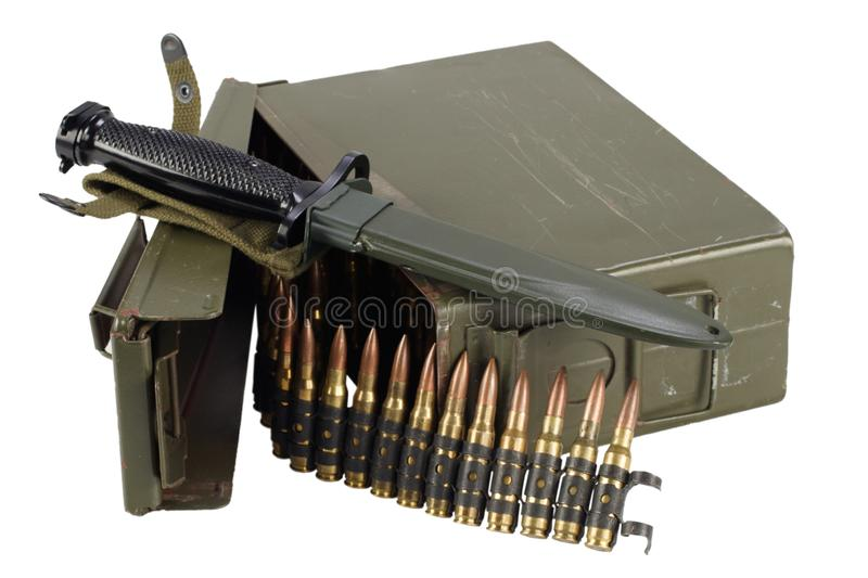 Green Ammo Box with ammunition belt and bayonet. Isolated on white background royalty free stock images