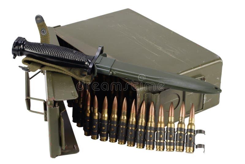 Green Ammo Box with ammunition belt and bayonet. Isolated on white background royalty free stock image