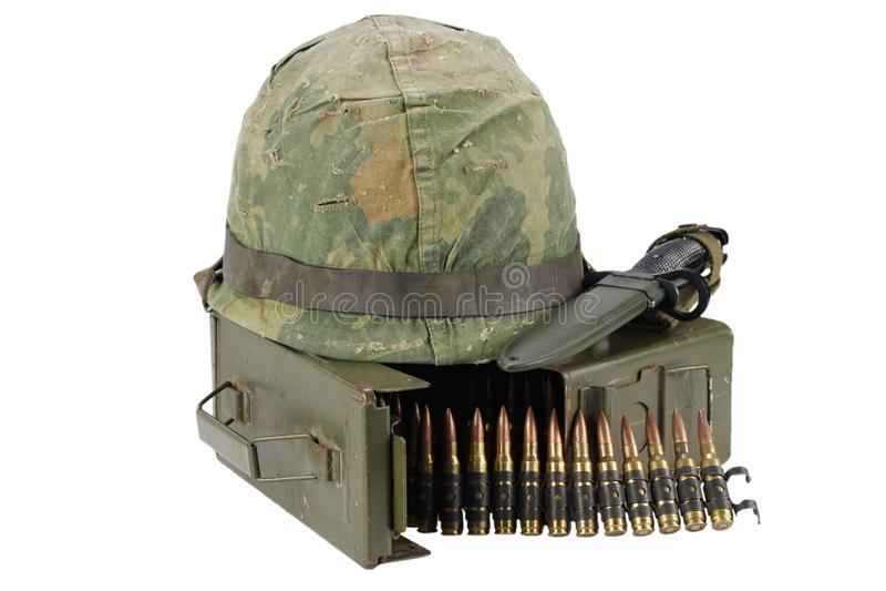 Green Ammo Box with ammunition belt and helmet. Isolated on white background stock image
