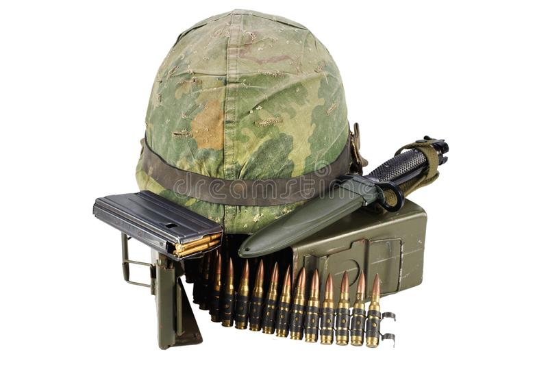 Green Ammo Box with ammunition belt and helmet. Isolated on white background royalty free stock image