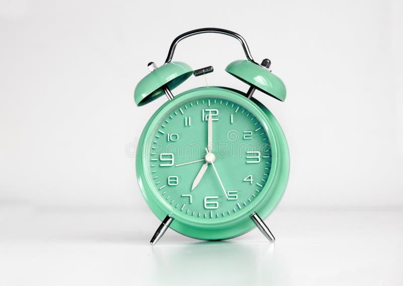 Green analog retro twin bell alarm clock. Isolated royalty free stock photos
