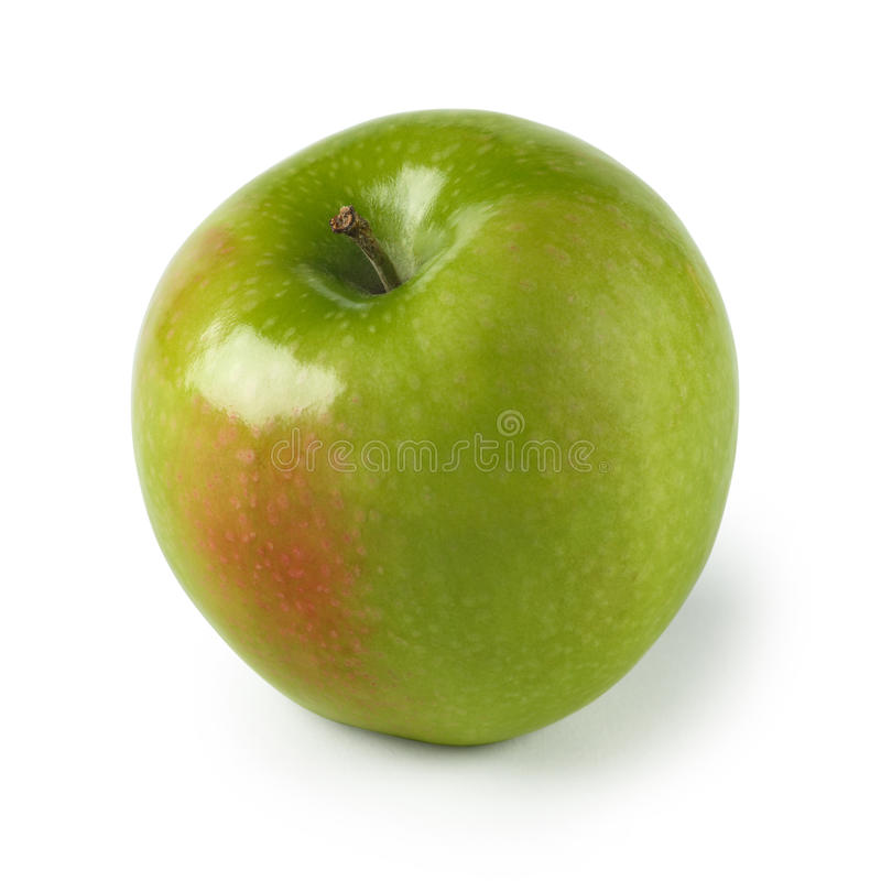 Green apple. An isolated image of a green apple with slight red section. Clipping path included stock photo