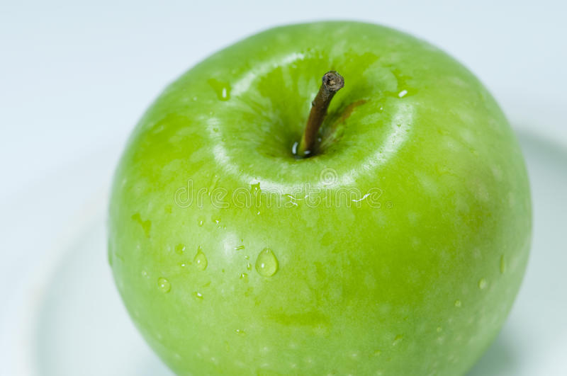 Green apple. In a white background stock images