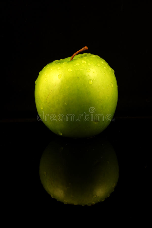 Green Apple. On black background was taken on:Auguest 24th ,2010 royalty free stock images