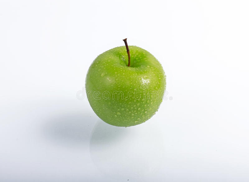 Green apple. With water drops royalty free stock photos