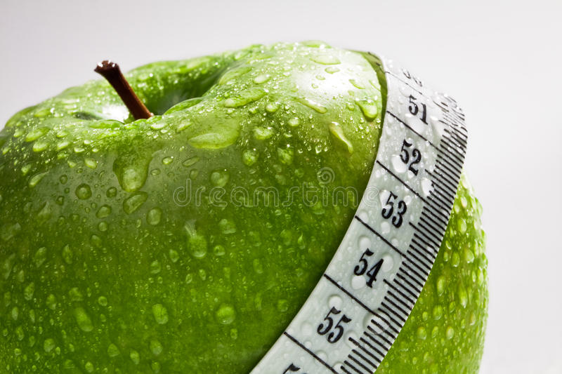 Green apple as concept of healthy diet royalty free stock image