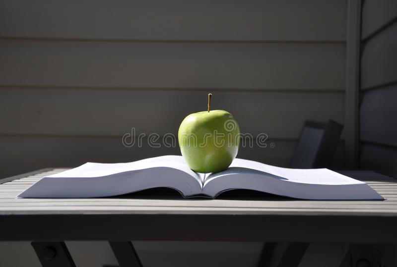 Green apple and book stock photo
