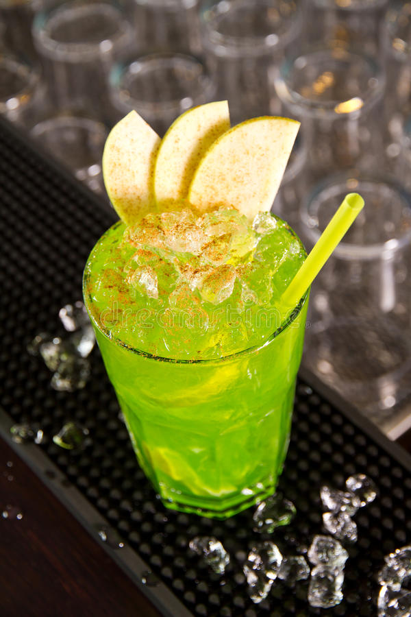 Green apple. Cocktail on the bar counter stock images