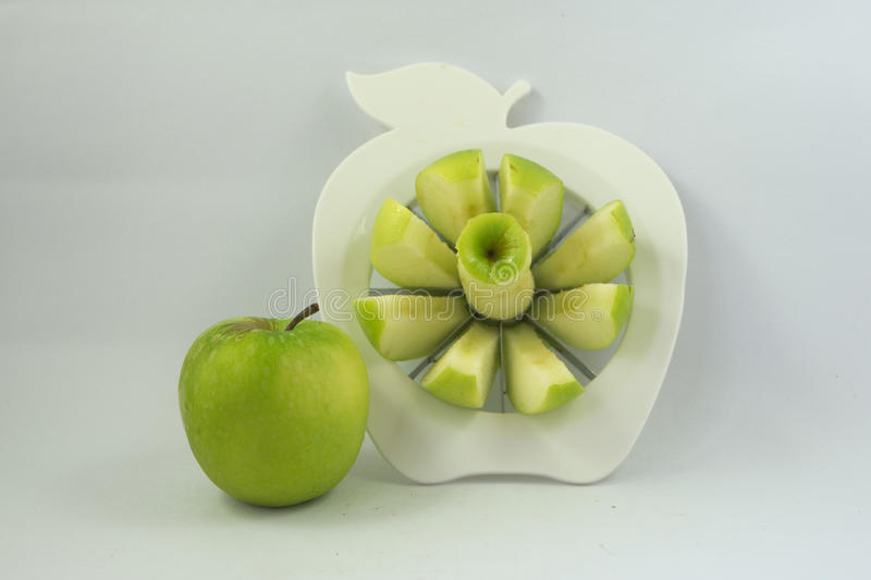 A green apple in a fruit-divider royalty free stock photos