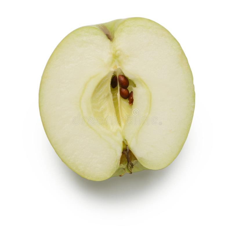 Green apple half on white. Background. Juicy pulp and seeds stock photography