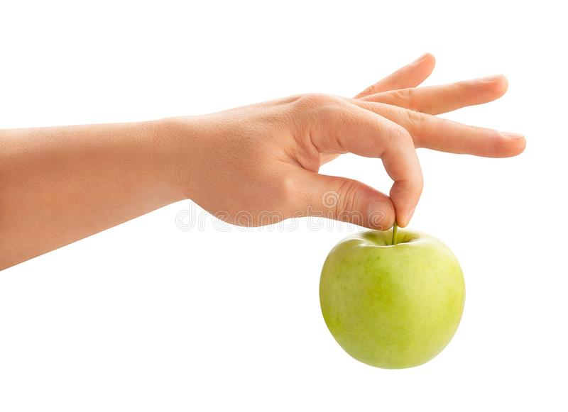 Green apple in hand royalty free stock photos
