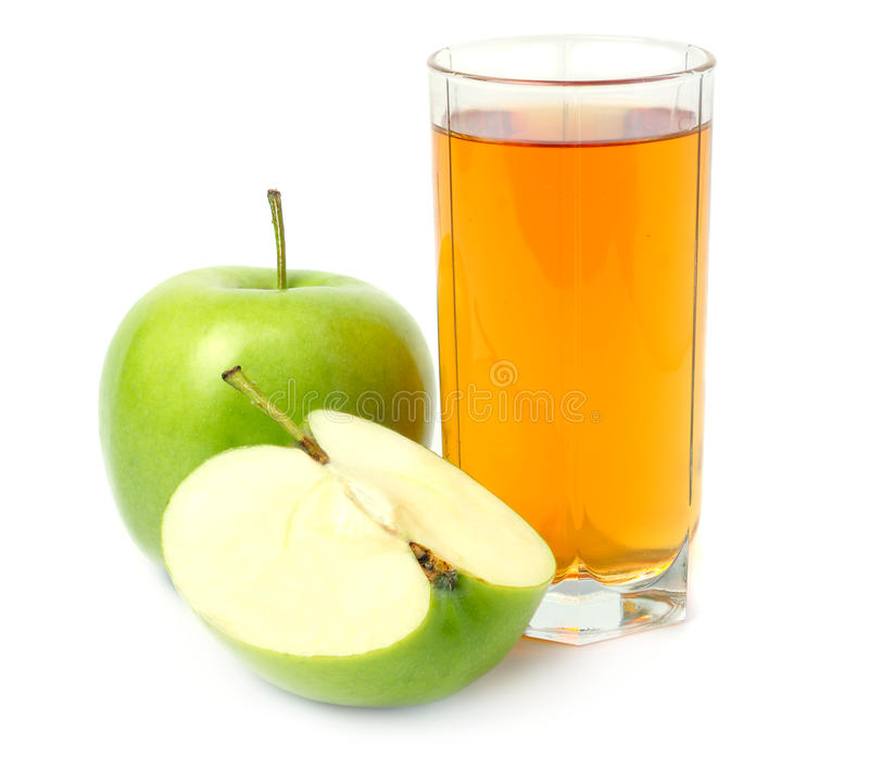 Green apple with juice isolated on white. Background royalty free stock photos
