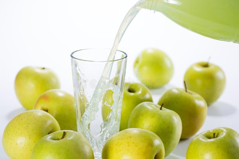 Green apple juice. Splash in glass royalty free stock photo