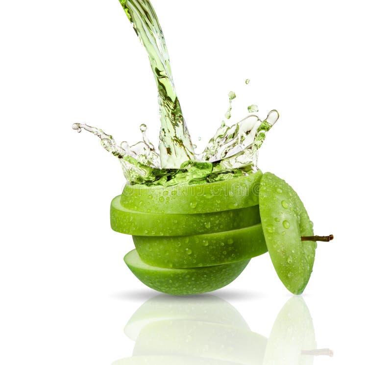 Green apple juice splashing with its fruits. Isolated on white background stock image