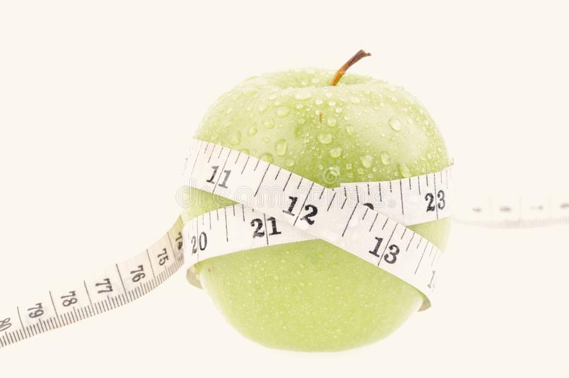 Green apple measured the meter royalty free stock photo