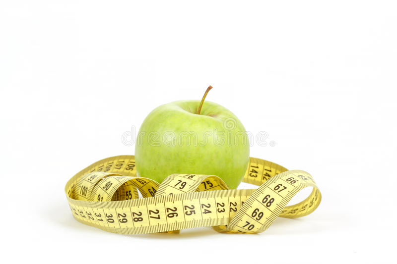 Green apple and measuring tape isolated on white background stock photos