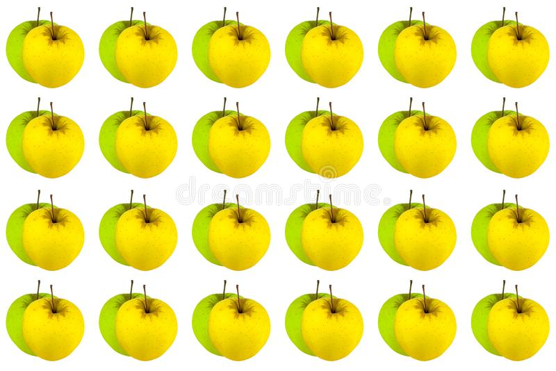 Green apple over yellow, background symmetrical bright juicy fruit pattern natural. Texture royalty free stock image