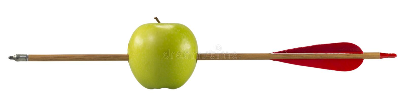 Green apple pierced by an arrow. On white background (with clipping path royalty free stock photos