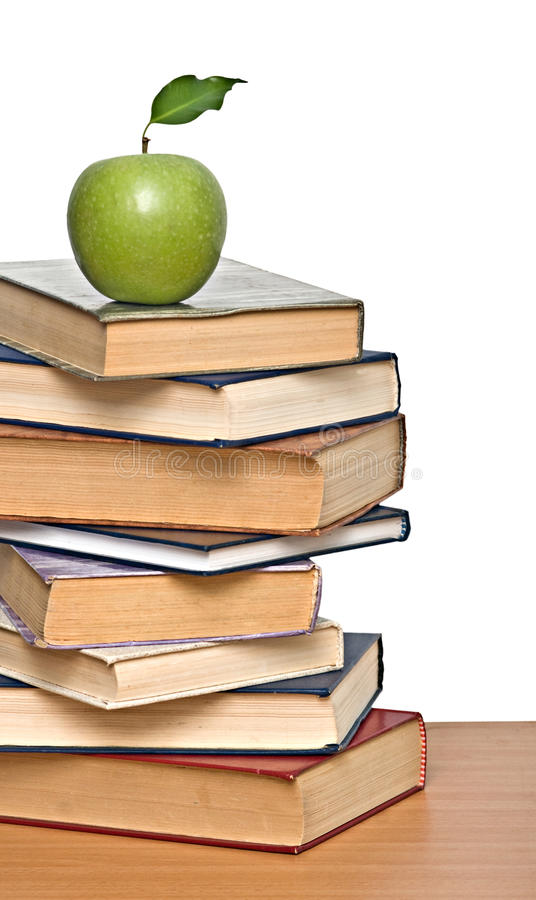 Green Apple On Pile Of Books Royalty Free Stock Photos
