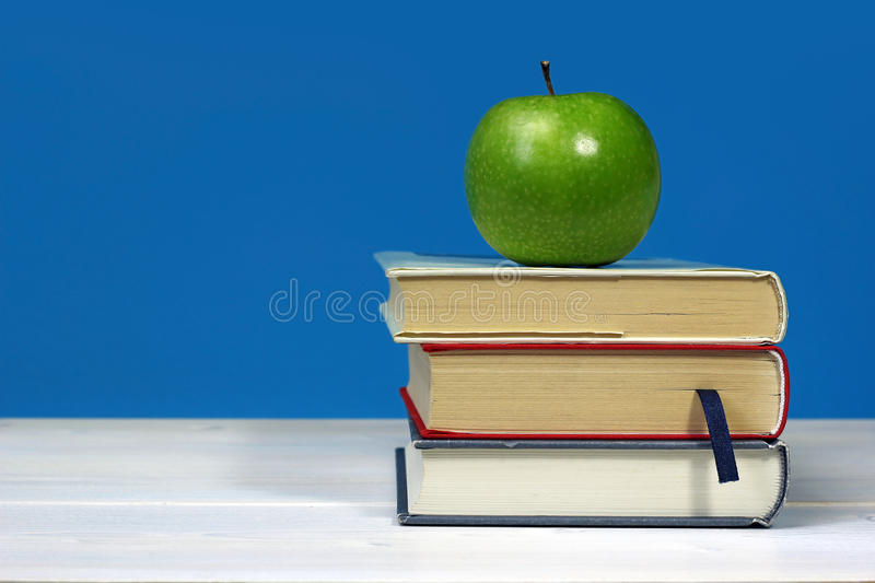 Download Green Apple On Pile Of Books Stock Photo - Image: 34786214