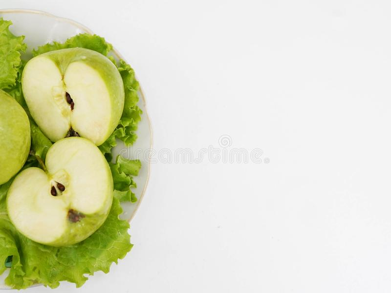 Green apple on plate on white background, copy space. healthy lifestyle, concept of dieting stock image