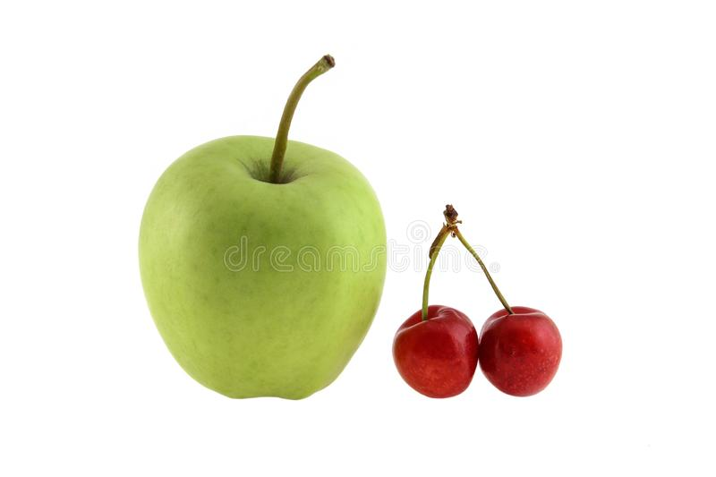 Green apple red sweet cherry isolated on white background as package design element stock photos
