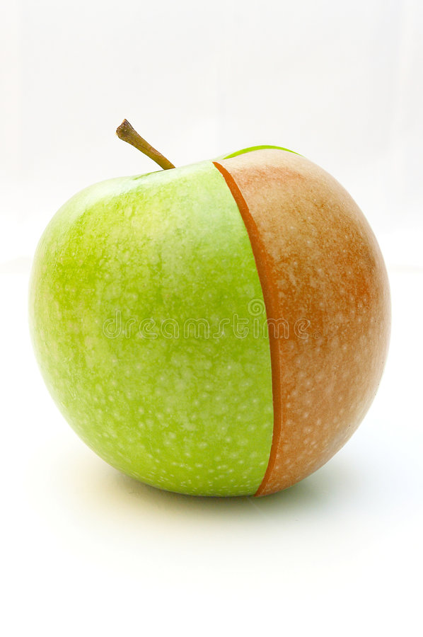 Green apple and red segment. Isolated stock photo