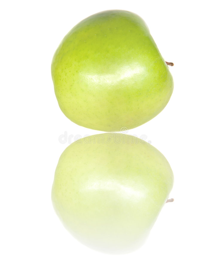 Green apple with reflection stock photography