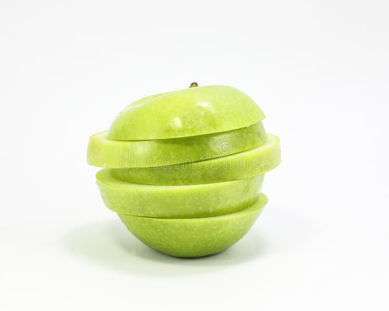 Green apple sliced stacked stock photos
