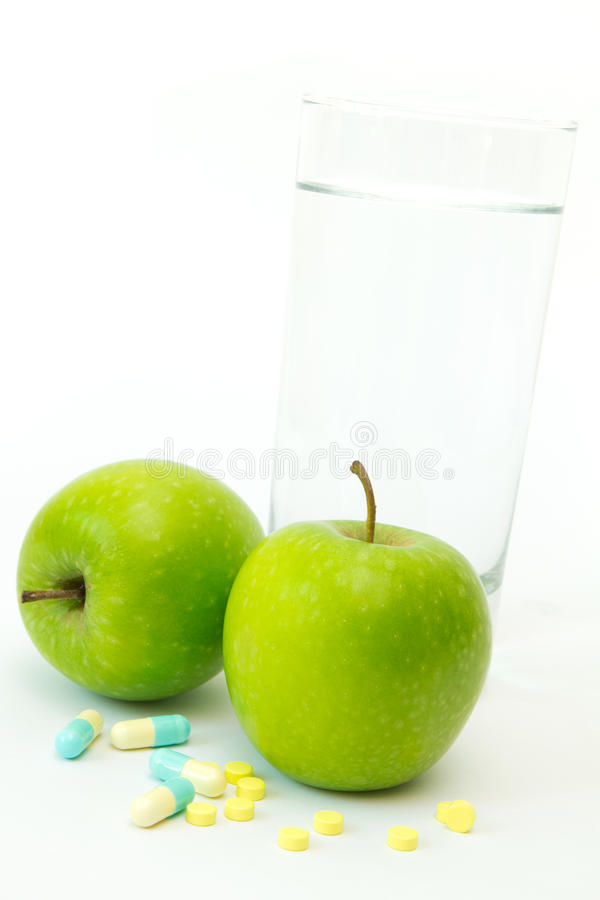 Green Apple With Slimming Pills Stock Photography