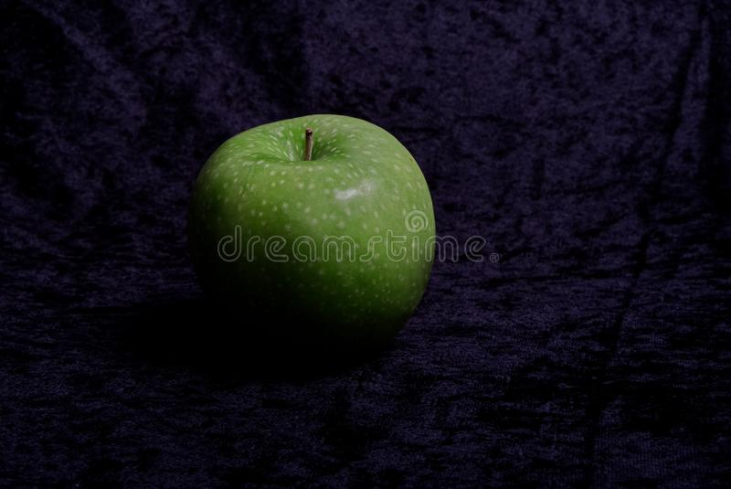 Green apple tastes sour and good royalty free stock photos