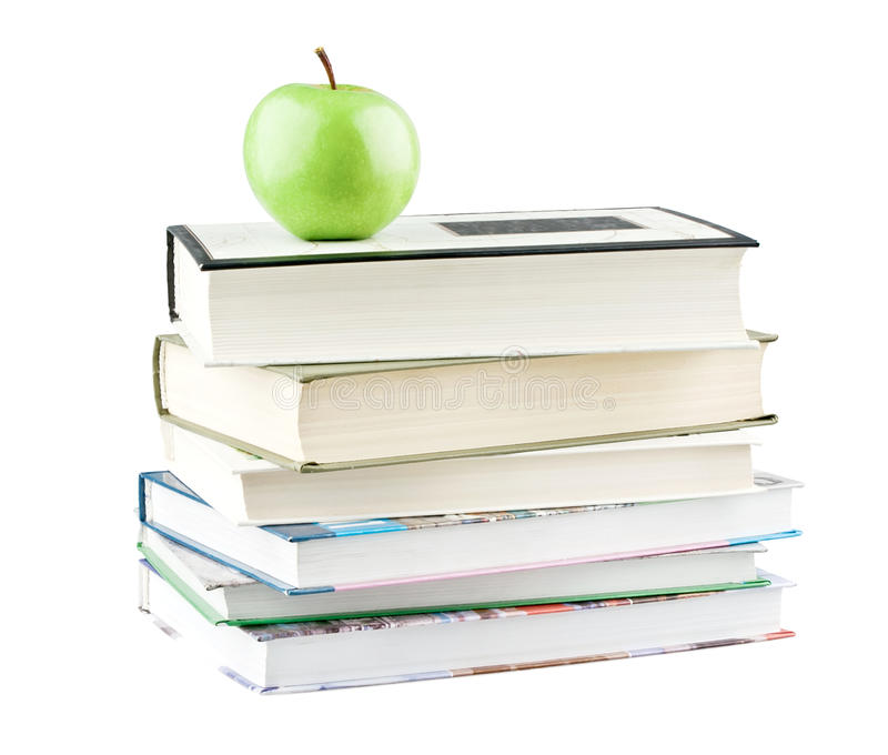Green apple on textbooks stock photo. Image of back ...