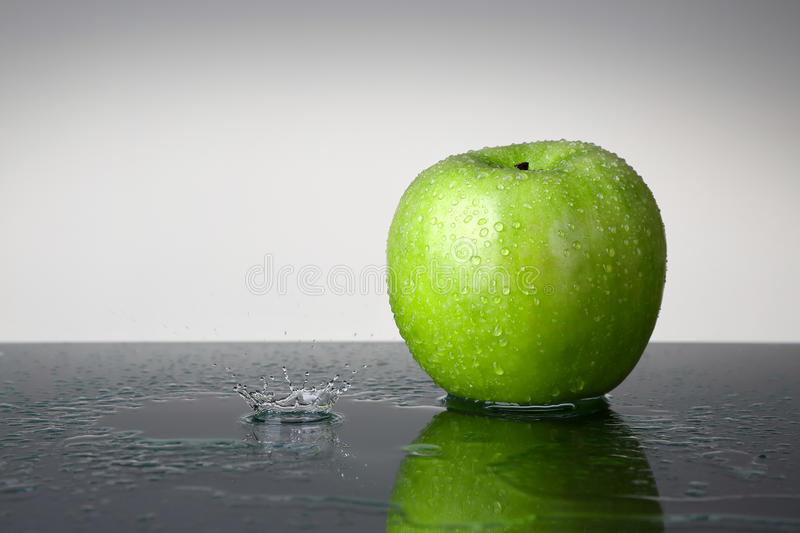 Green apple with water drop stock photo