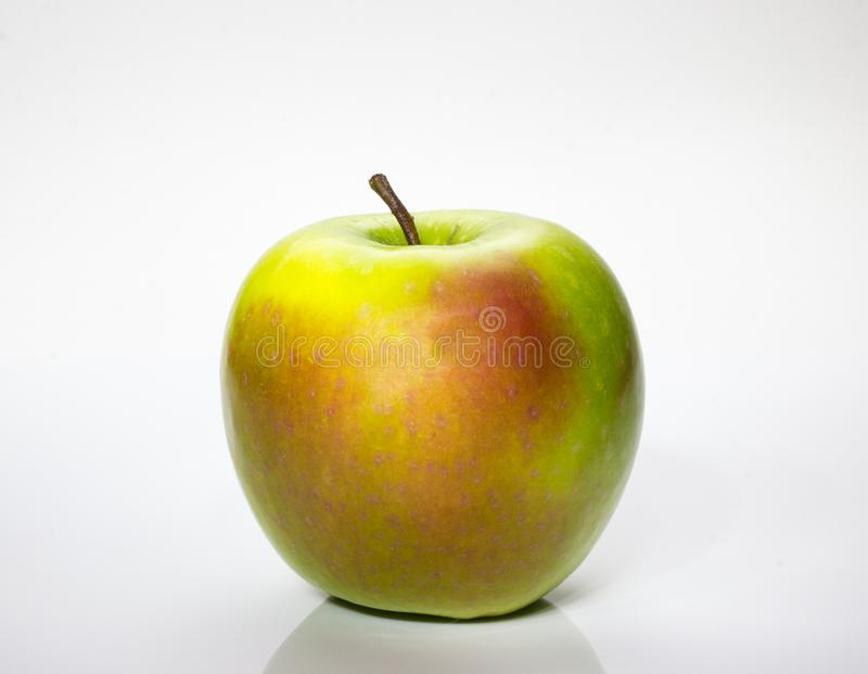 Green apple on a white background royalty free stock photo