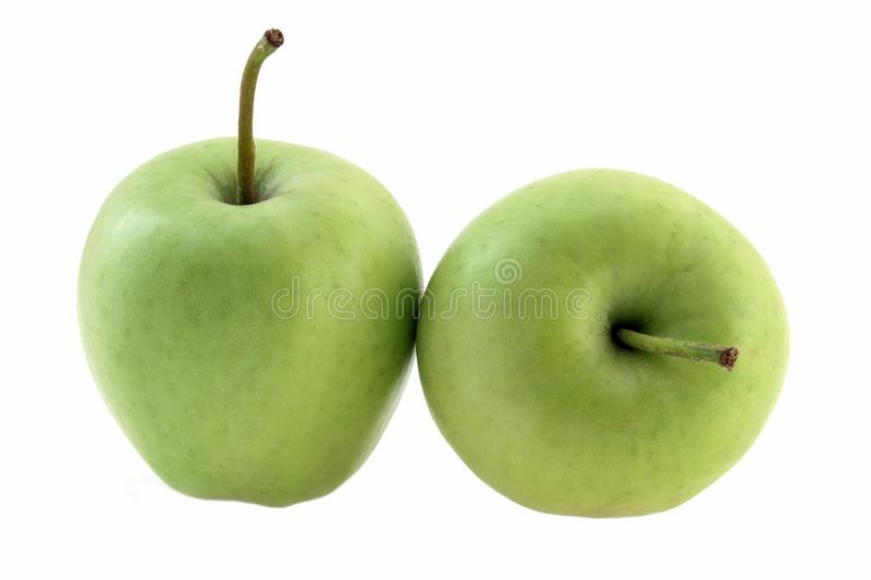 Green apples on white background, fruit healthy concept, side view royalty free stock image