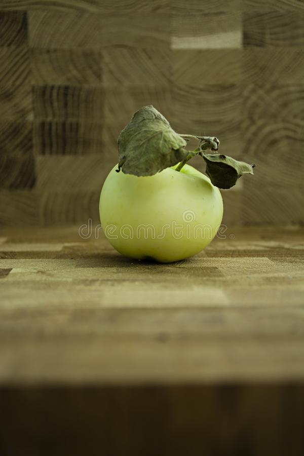 Green apple on a wooden background stock photo