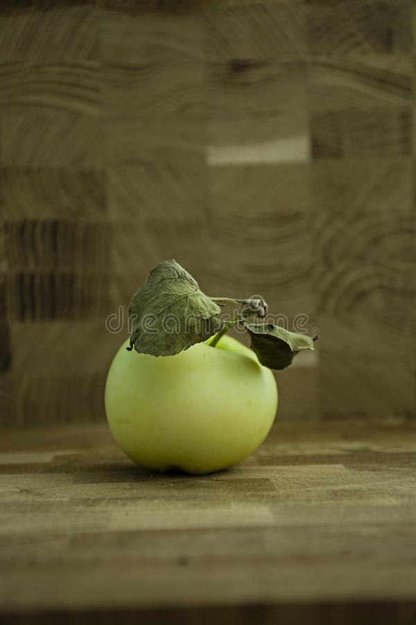 Green apple on a wooden background royalty free stock images