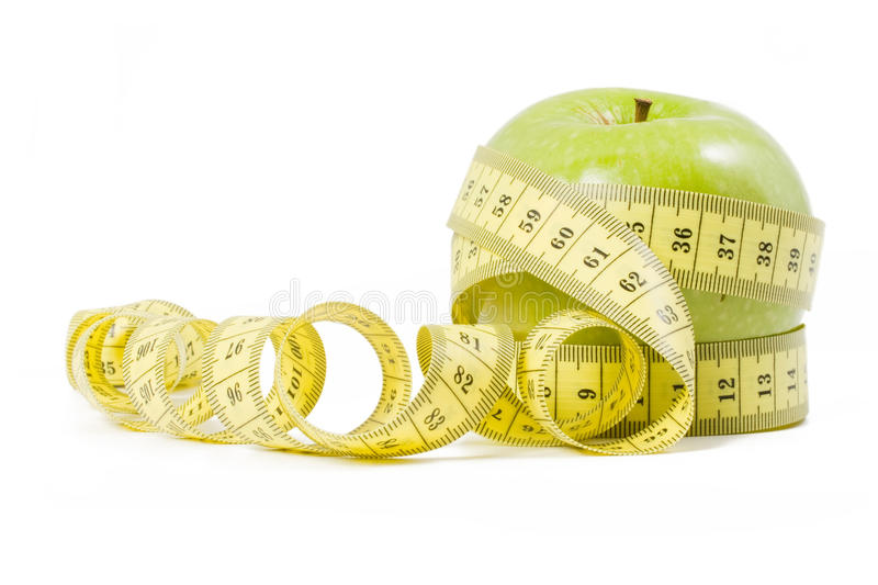 Green apple wrapped in centimetre royalty free stock photos