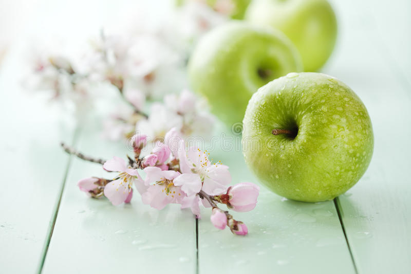 Green apples. Fresh green apples with water drops, shallow dof royalty free stock images