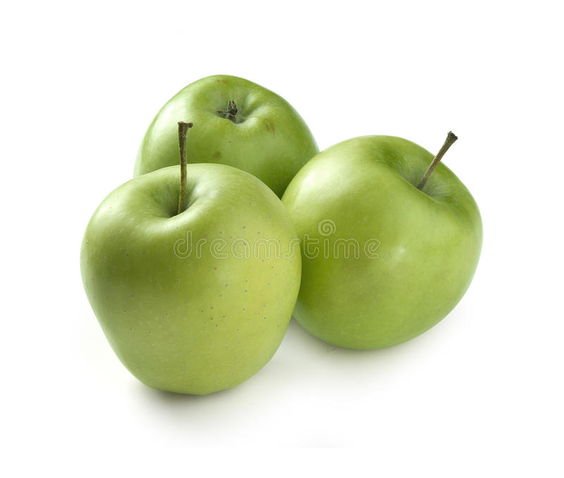 Green apples. Three fresh green apples on the white background stock photography