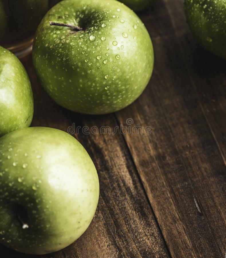 Green Apples on Brown Surface royalty free stock image
