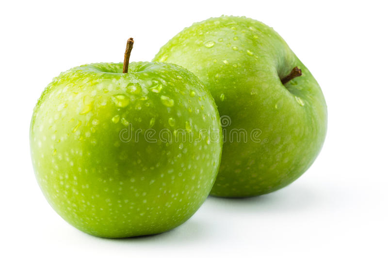 Green Apples. Granny Smith covered in water droplets against a white background stock photography