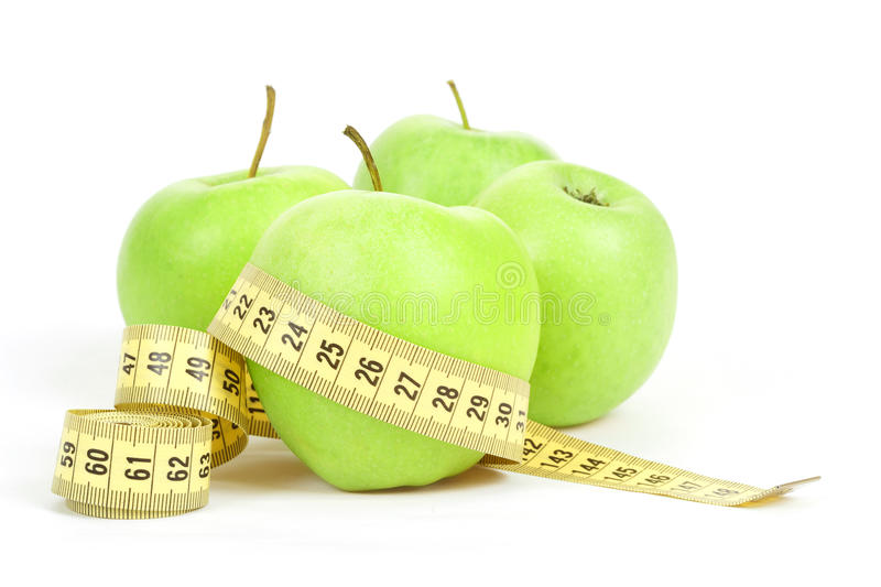 Download Green Apples And Measuring Tape Isolated On White Background Stock Image - Image: 29199627