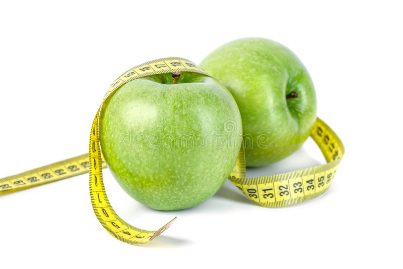 Green apples with Measuring tape on white background royalty free stock photography
